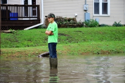 Young Boy Overlooks the Cedar River Flooding www.usathroughoureyes.com