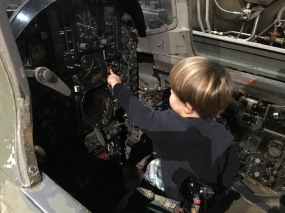Future pilot? A young boy pushes one of the incredible number of buttons in a jet cockpit at the Museum of Aviation, Warner Robins, GA. / ©2016 Audrey Horn Photo / www.usathroughoureyes.com
