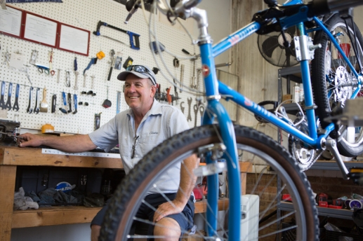 Kevin Hand, Apalachicola Community Bikes, shares stories with Tom in his bike shop, Apalachicola, FL. / ©2017 Audrey Horn / www.usathroughoureyes.com