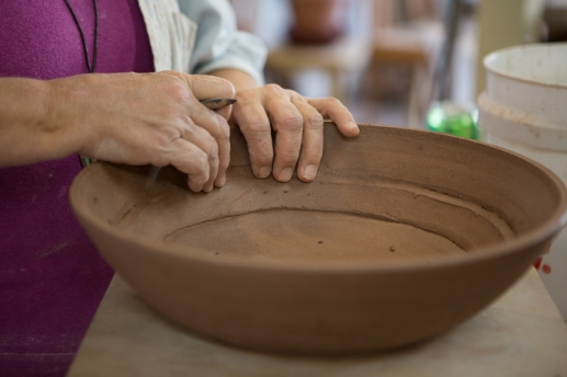 Beth Weitz, potter, makes a bowl in her studio, Muddy Evolution, in Apalachicola, FL. / ©2017 Audrey Horn / www.usathroughoureyes.com
